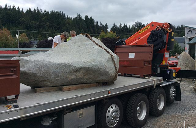 Truck carrying large rock